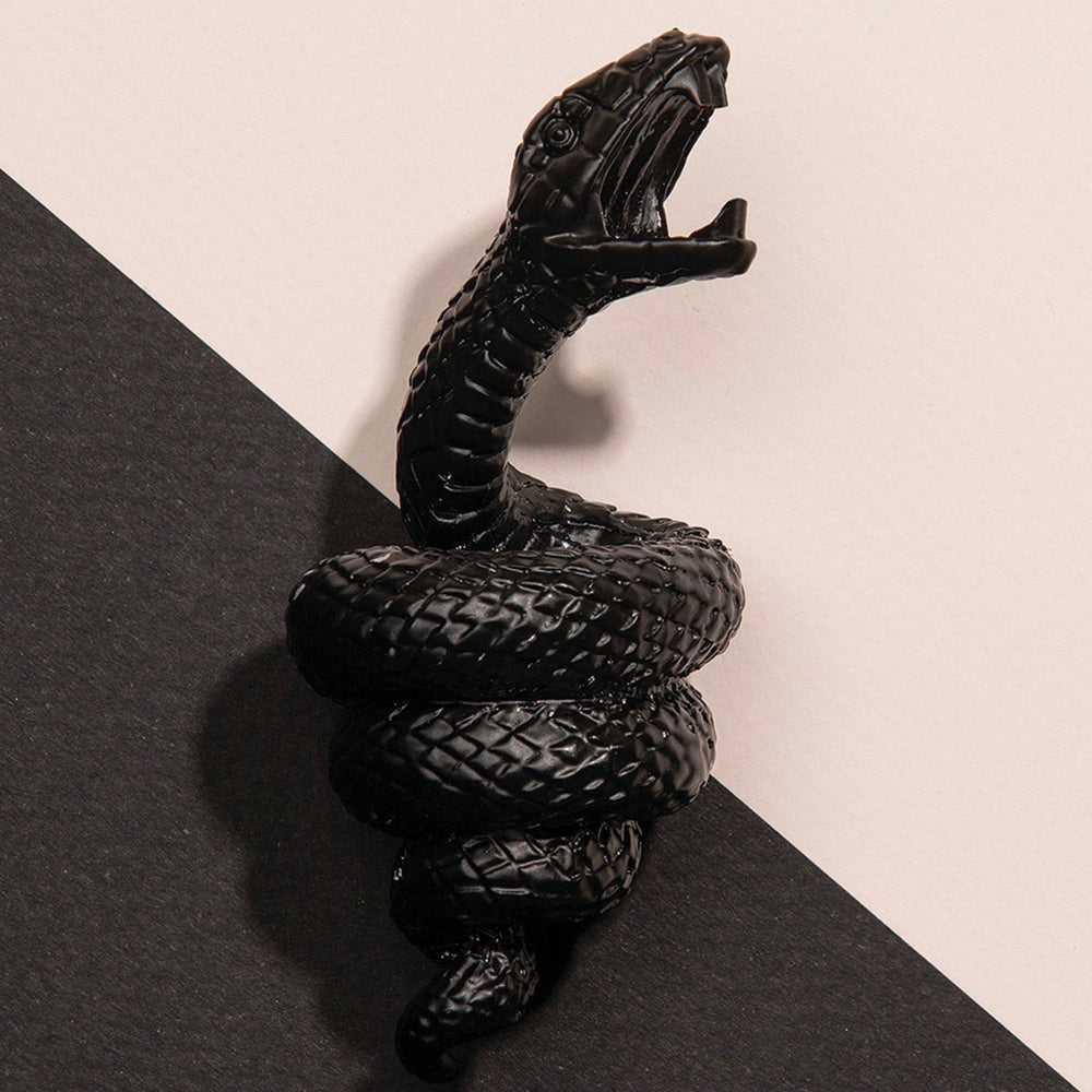 Bottle opener with a mamba snake in black