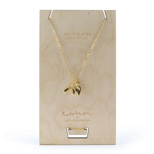 Necklace with a Swallow bird pendant in gold by Katy Welsh