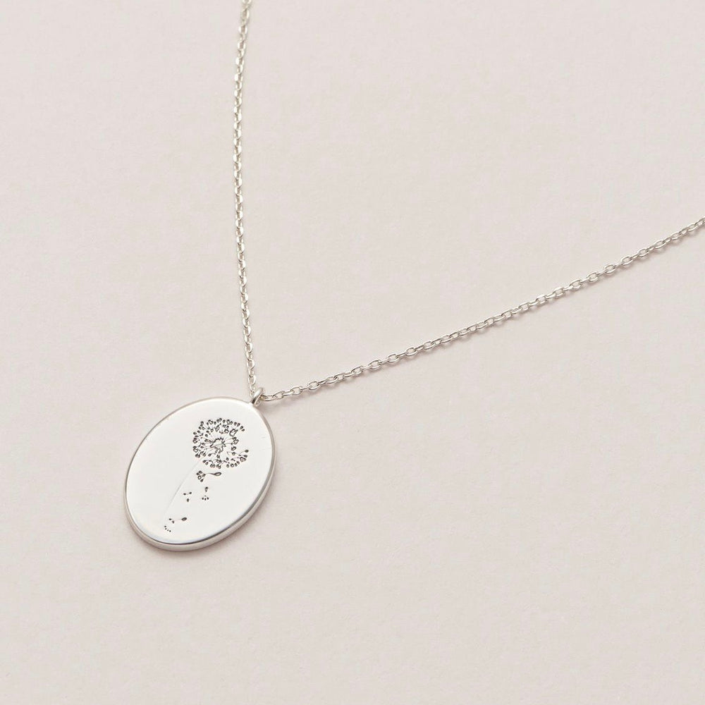 Necklace with a dandelion pendant in silver