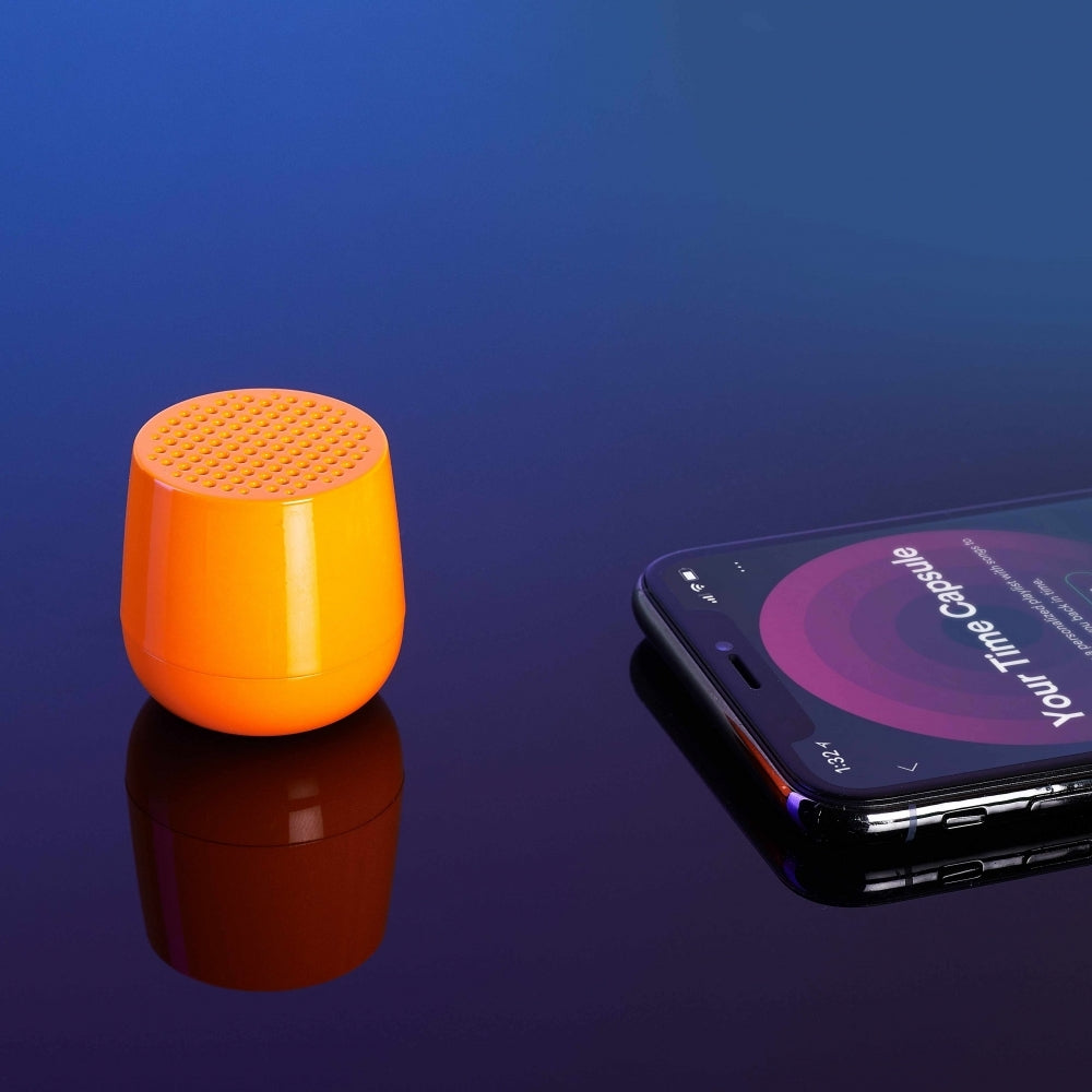 Ultra-portable bluetooth speaker in neon orange