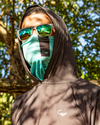 Man wearing a tie-dye performance fishing sun mask, fishing hoodie and costa del mar sunglasses. From fishing apparel brand, Jigalode.