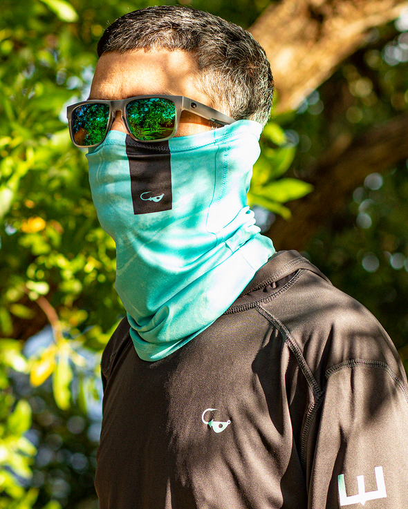 Man wearing a tie-dye performance fishing sun mask and costa del mar sunglasses. From fishing apparel brand, Jigalode.