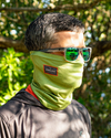 Man wearing a green topographic performance fishing sun mask and costa del mar sunglasses. From fishing apparel brand, Jigalode.