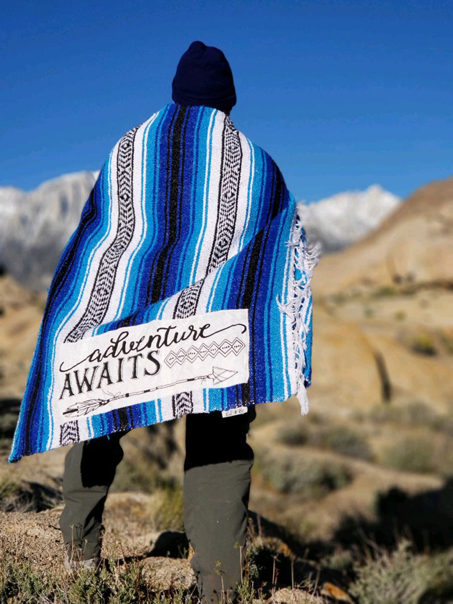 "Hiker wrapped with ""Adventure Awaits"" Blue Throw Blanket"