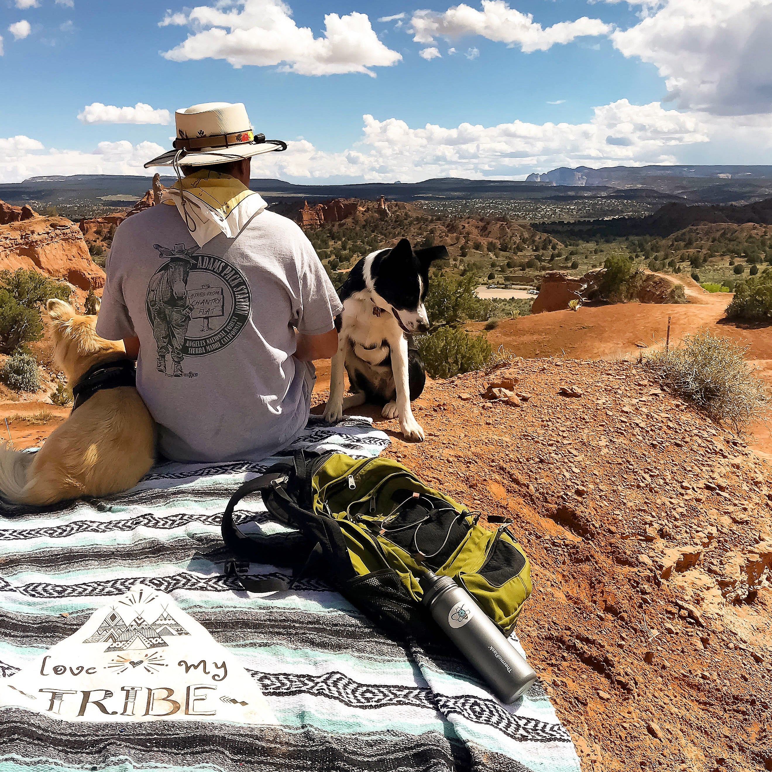Hiker with his two dogs on top of mountain taking in the views with their Lil Be Blankets