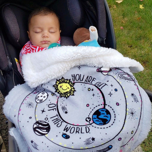 Baby in their stroller wrapped in Galaxy Security Blanket