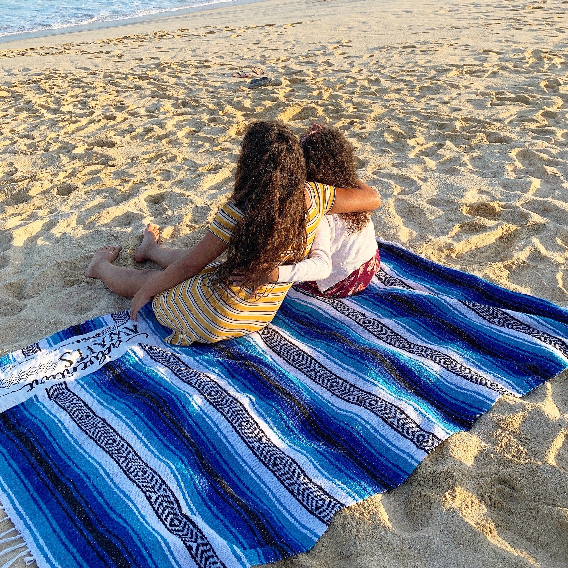 Life Style Picture of Family Mexican Blanket Being Used on the Beach