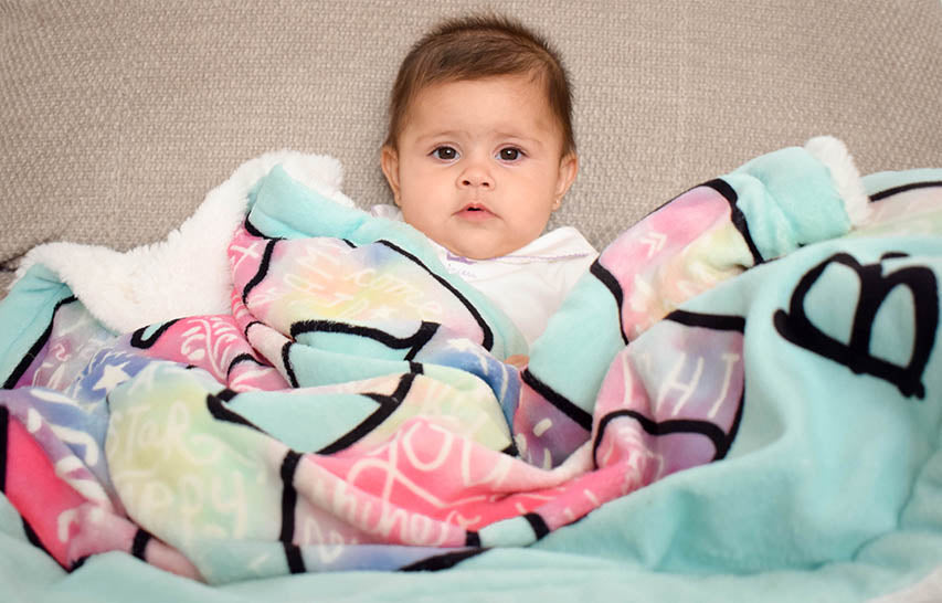 Baby Girl Covered in Dream Big Baby Blanket