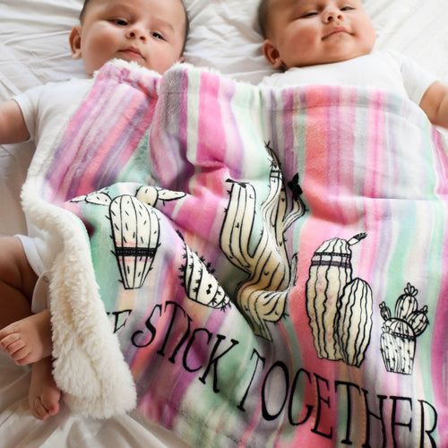 baby twin boys sharing their We Stick Together Security Blanket