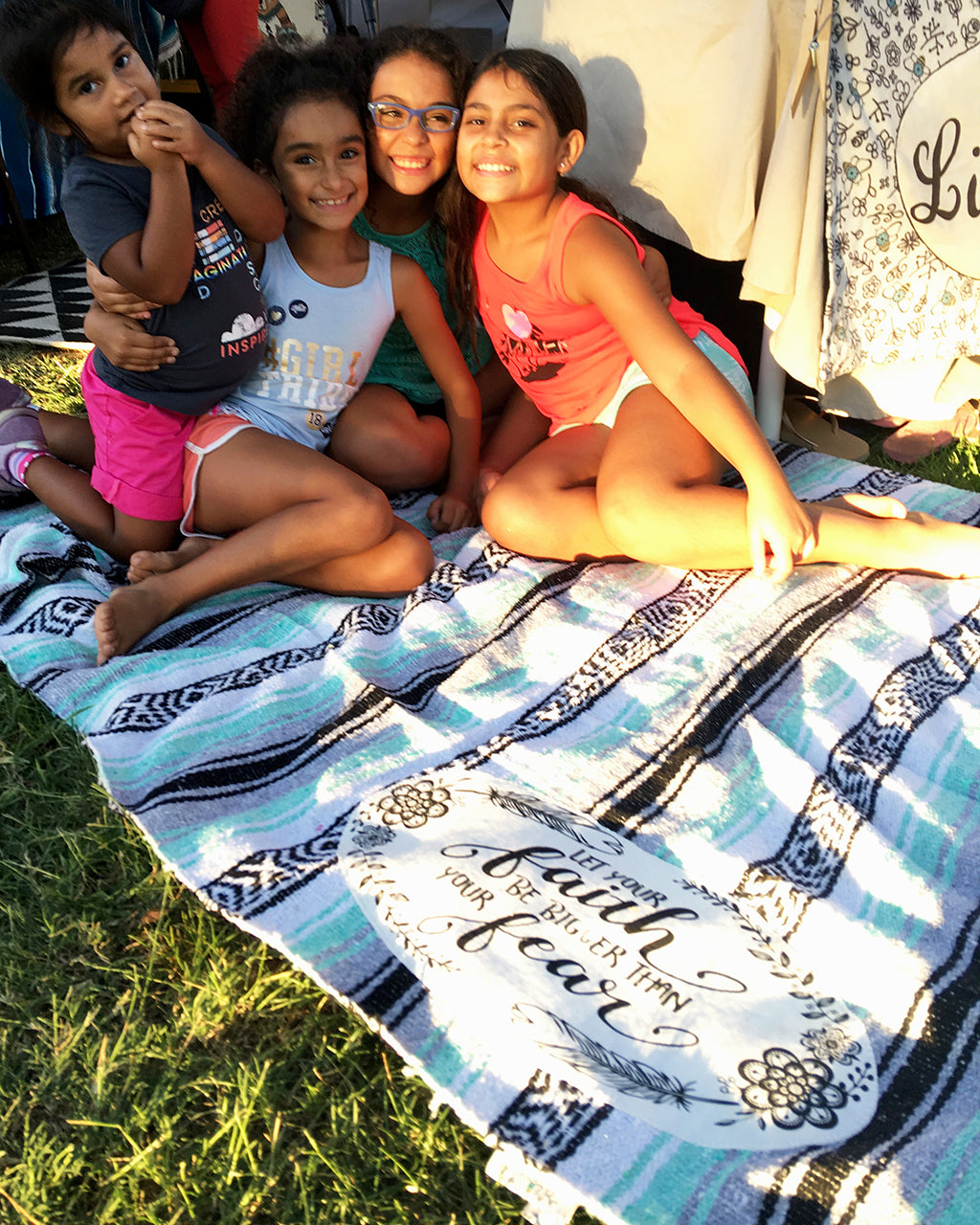 4 girls smiling on mexican throw blanket
