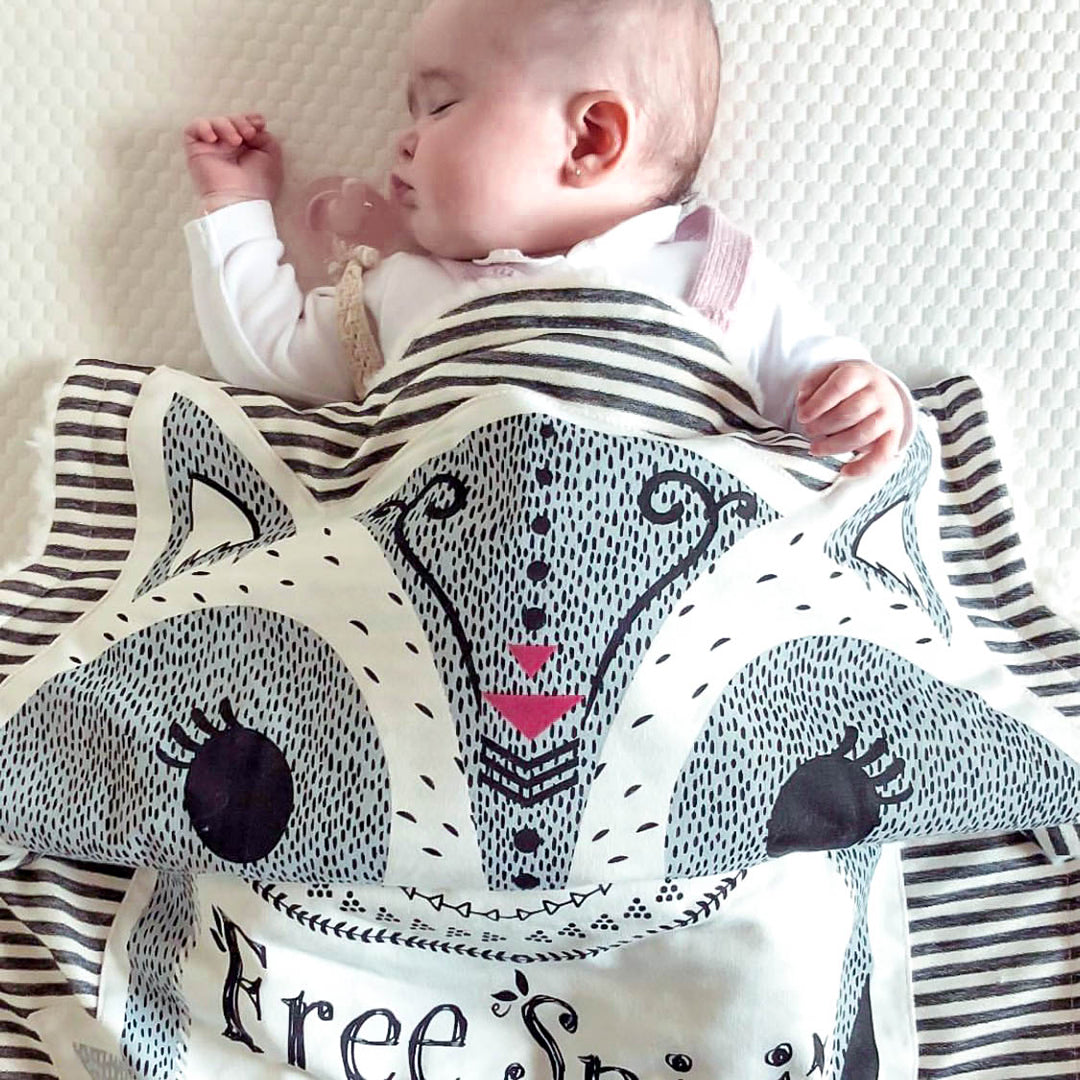 Baby Covered in Riley the Raccoon Baby Blanket Free Spirit
