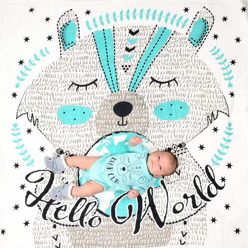 Baby on Hello World Swaddle Blanket