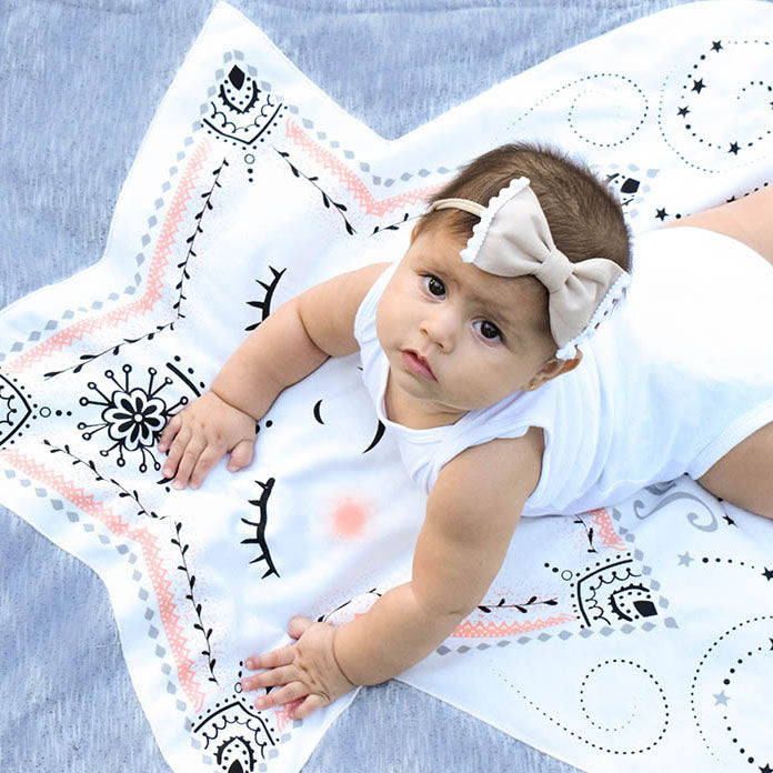 Baby doing Tummy Time on Skylar the Star Baby Character Blanket