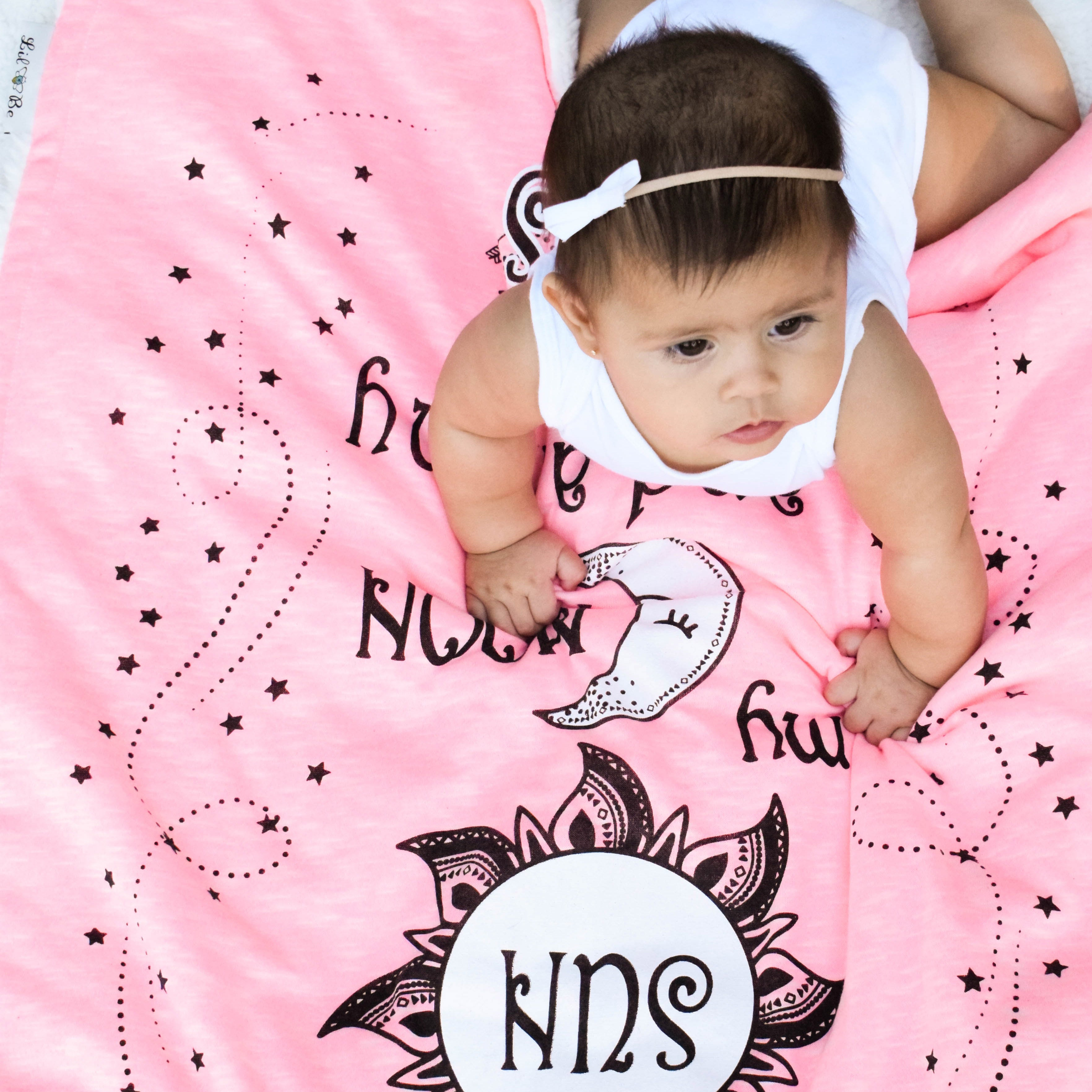 baby girl on Sun Moon Stars baby blanket