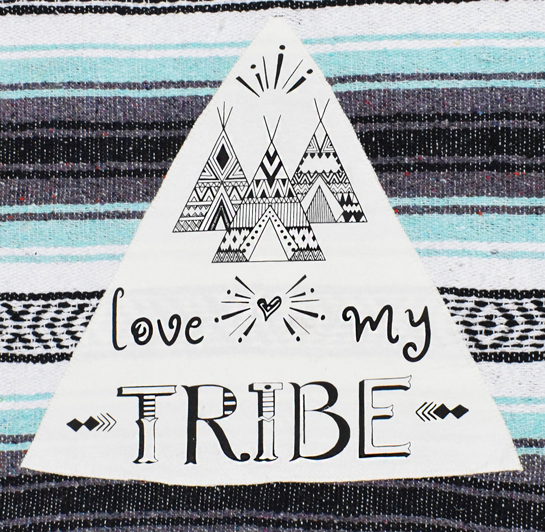 "Patch of ""Love my Tribe"" on mexican blanket"
