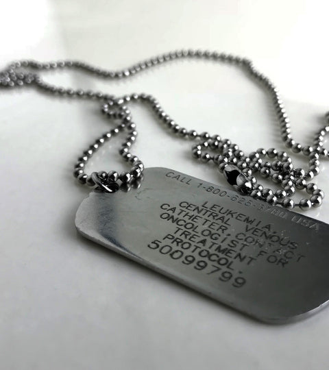 Medical ID tag by Medic Alert. Alerts medical and emergency services of user's medical condition and protocol.