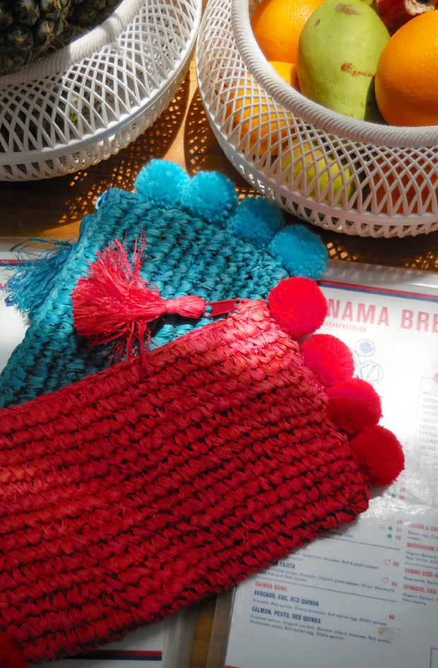 Brunna Canggu Woven Straw Clutch - in Bali Red with Red Pom-poms 1