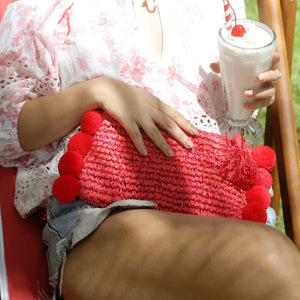 Brunna Canggu Woven Straw Clutch - in Bali Red with Red Pom-poms