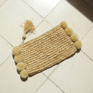 Brunna Canggu Woven Straw Clutch - in Natural Tan Raffia & Pom-poms
