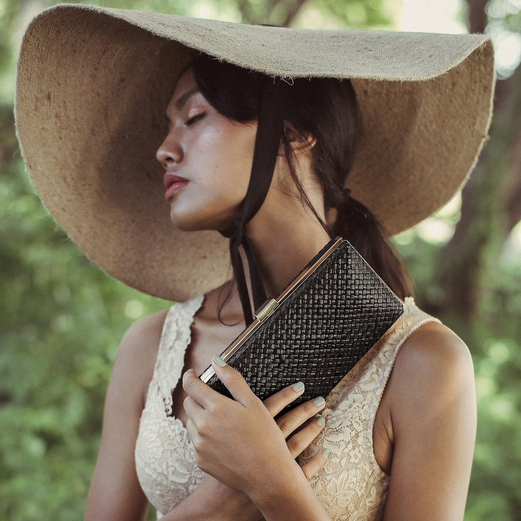Gitta Jett Black Handwoven Straw Clutch