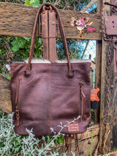 BROWN ROLLED LEATHER HANDBAG