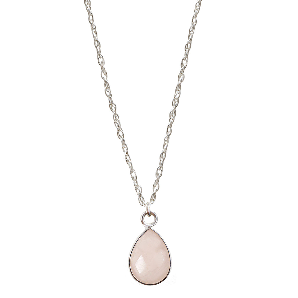Faceted rose quartz teardrop shaped gemstone encased in sterling silver hanging from sterling silver rope chain; shown on white background