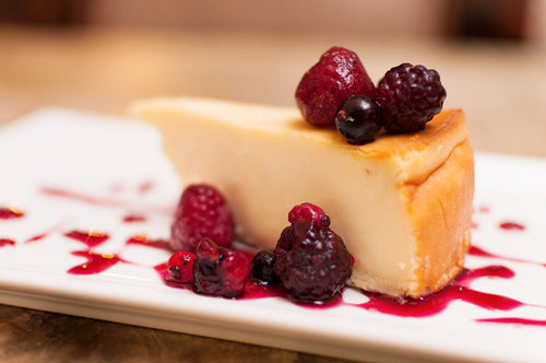 Cheese cake con coulis de frutos del bosque