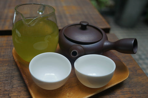 green tea with two bowls and a pot