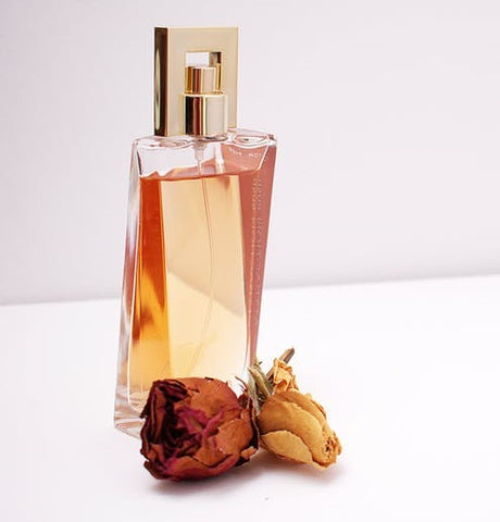 perfume with dried rose flower