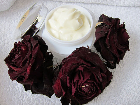 skin care cream with roses around