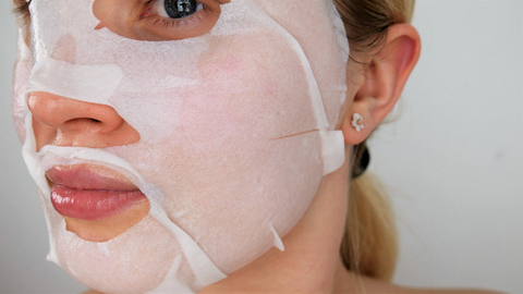 woman wearing facial sheet mask