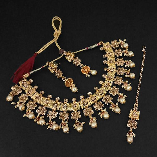 Kriaa Gold Plated Brown Austrian Stone Necklace Set With Maang Tikka -1107991A - L