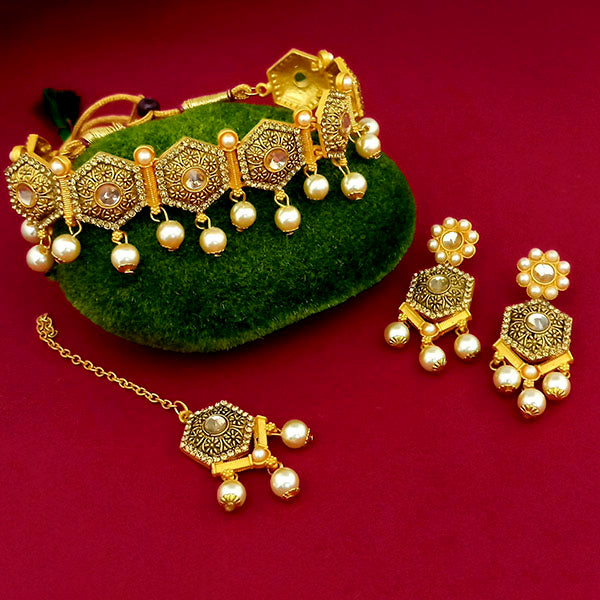 Kriaa Gold Plated Brown Austrian Stone Necklace Set With Maang Tikka - 1113815