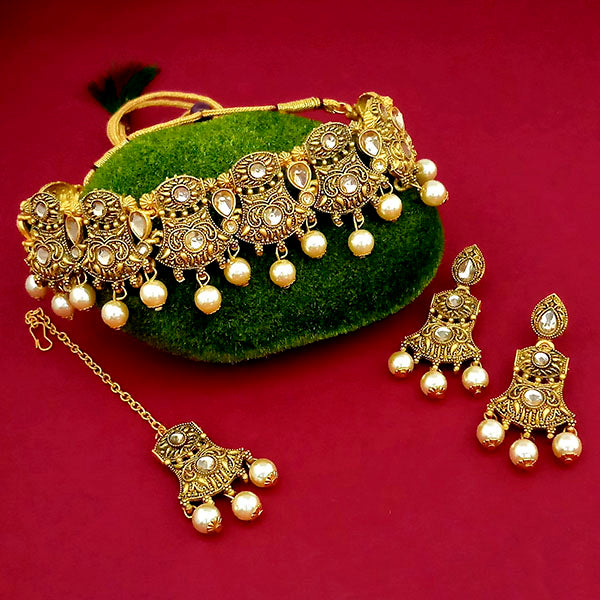 Kriaa Gold Plated Brown Austrian Stone Necklace Set With Maang Tikka - 1113816