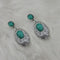Kriaa Green Stone Rhodium Plated Dangler Earrings