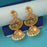 Kriaa Brown Austrian Stone Gold Plated Jhumki Earrings