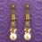 Kriaa Antique Gold Plated Brown Stone Pearl Dangler Earrings