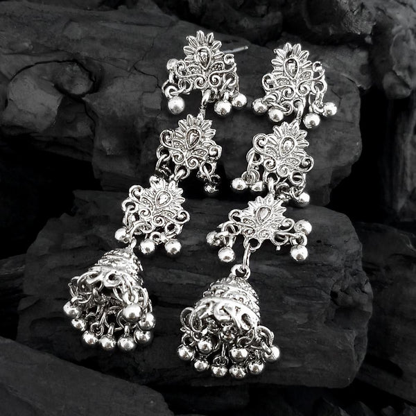 Step out in style with this beautiful oxidised silver plated earrings, which have been given a drop designer dangler perfectly designed. It will add bling to your look. This earring will go well with any of your ethnic outfits. • Material: Zinc Alloy • Type: Earrings • Sku Code: 1317048