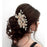 Apurva Pearls White Austrian Stone Gold Plated Floral Hair Brooch