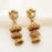 Kriaa Austrian Stone Gold Plated Jhumki Earrings
