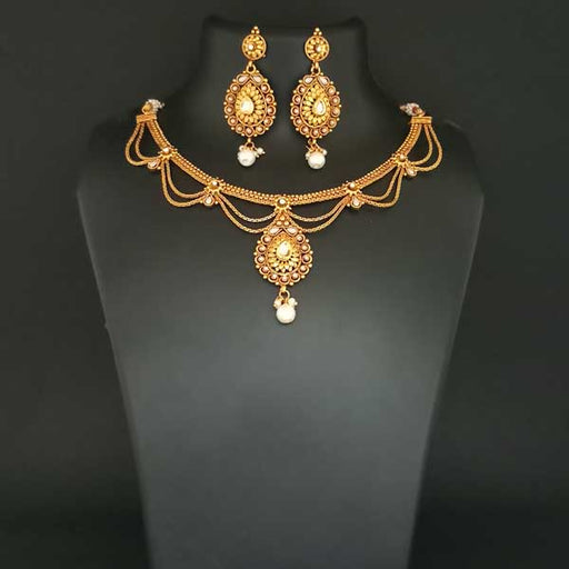 Utkrishtt Kundan Gold Plated Pearl Drop Copper Necklace Set