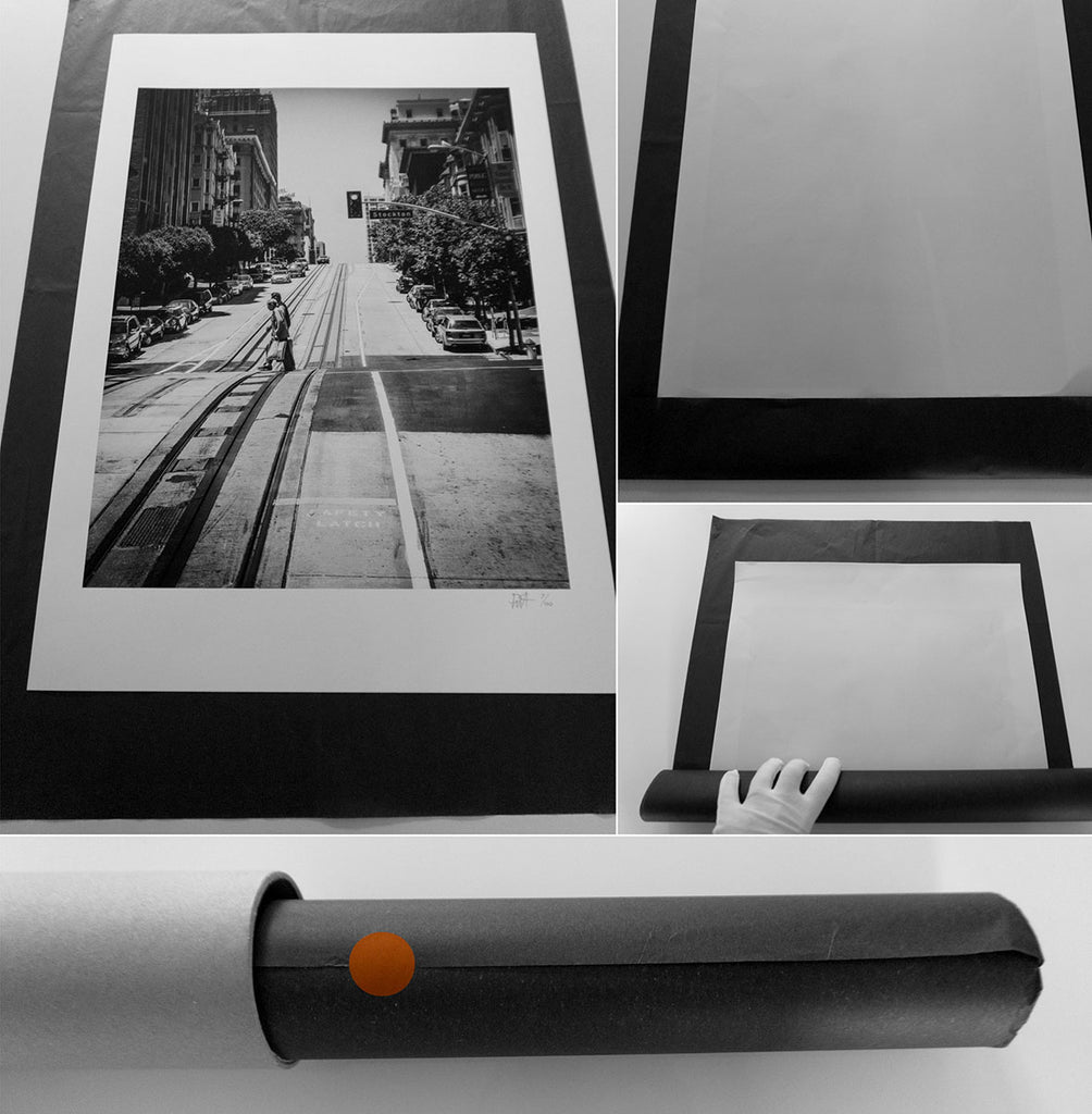 Wrapping and packing the fine art photography print in tissue paper and cardboard tube.