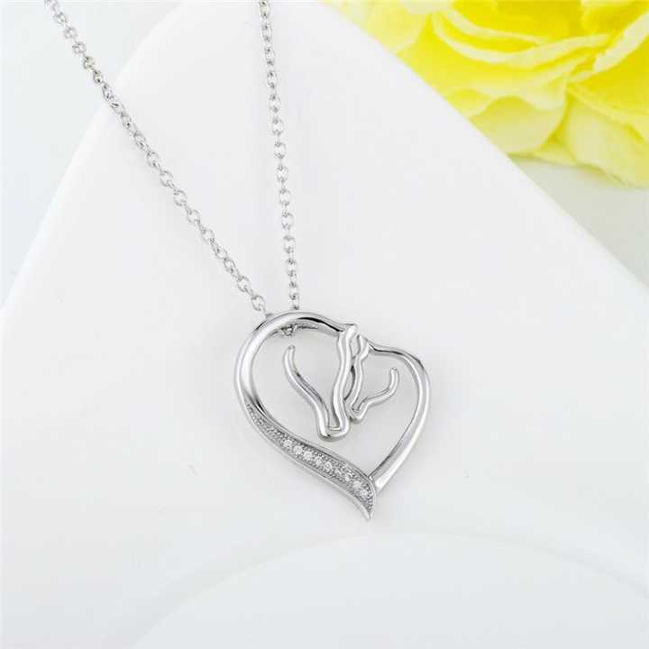 A beautiful 'just you and me'heart shape horse head necklace
