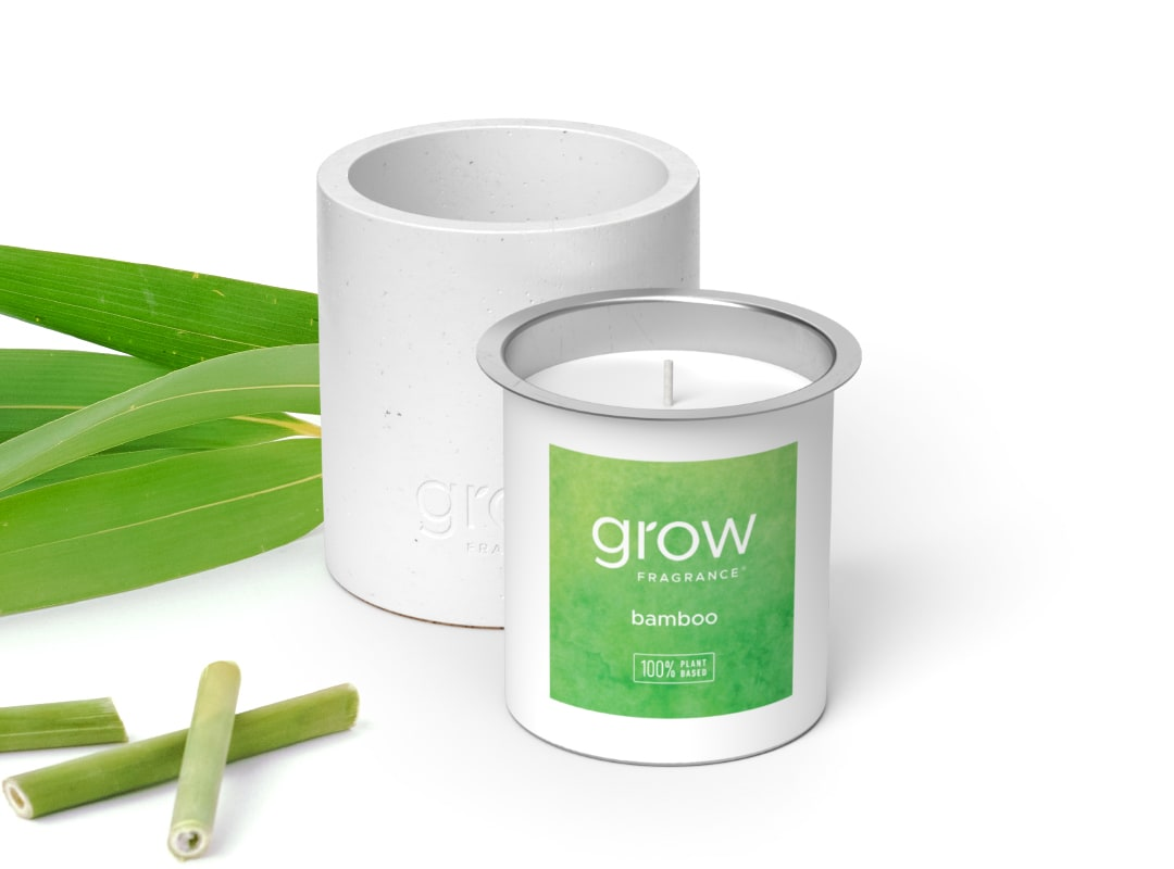 Bamboo Candle - Bamboo has notes of green foliage, citrus and pink peppercorn.  Comes with a white reusable candle vessel.