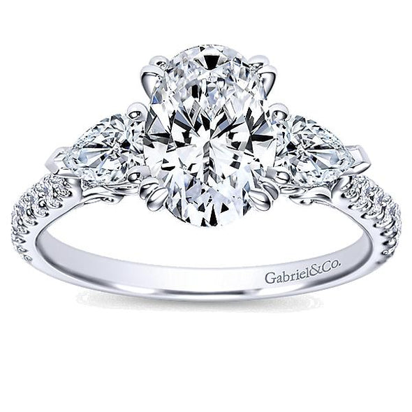 Contemporary Oval and Pear Three Stone Diamond Engagement Ring