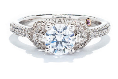 This beautiful 18K White Gold Contemporary Engagement Ring is brought to you by Adele Diamond.