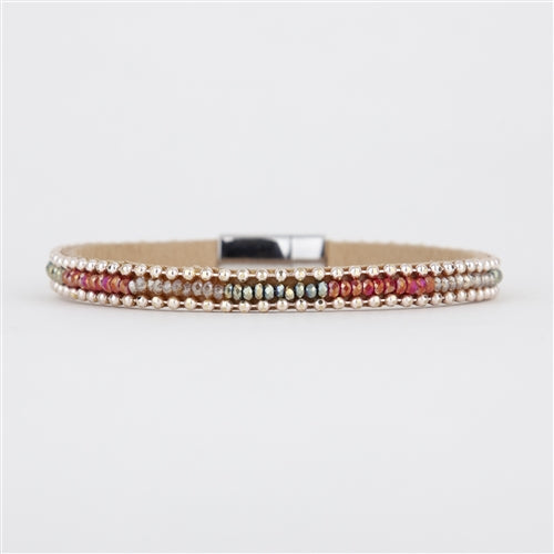 Leather based bracelet with sparkling colored beads