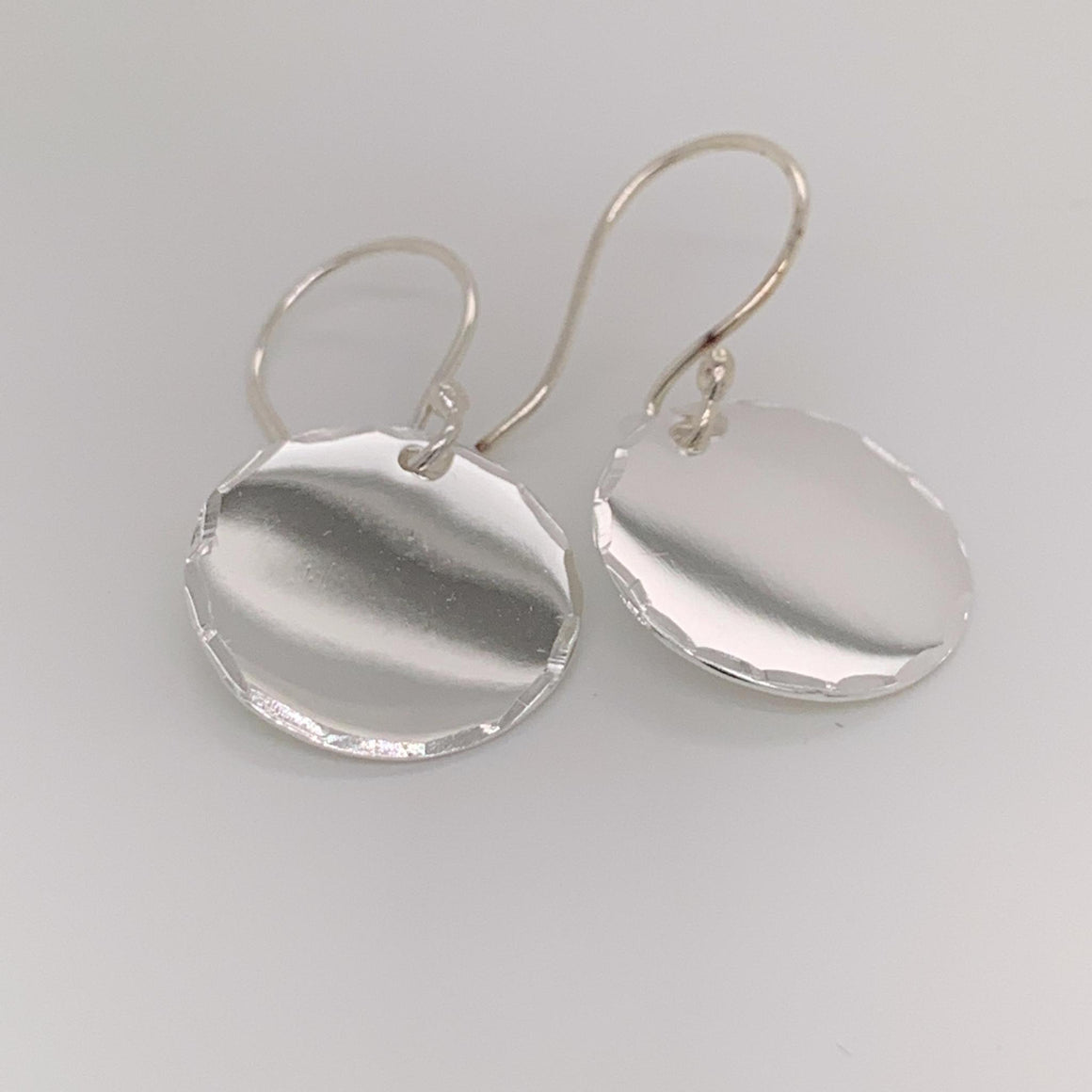 GERMAN SILVER ROUND EARRINGS WITH DIAMOND CUT TRIM - Atlanta Jewelers Supply
