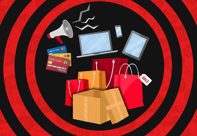 Excitement about the Black Friday sale; shopping bags, credit cards, online shopping from smartphones and laptops