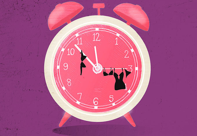 A clock showing seven till midnight time with lingerie hanging off clock hands